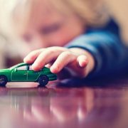 gty_child_playing_with_car_jc_150107_12x5_1600