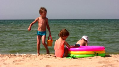 stock-footage-group-children-play-on-beach
