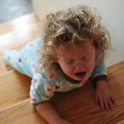 Toddler-crying-on-stairs