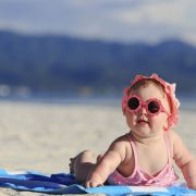 cute baby girl on tropical beach