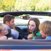 01_kids-Arguing-In-Convertible-Road-Trip-Parents