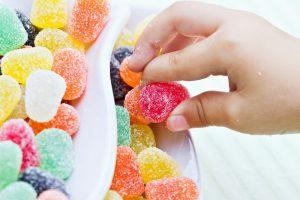 child_grabbing_candy