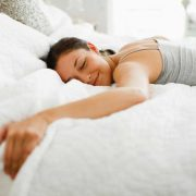 woman-sleeping-in-on-weekend