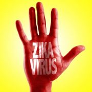 bigstock-Zika-Virus-written-on-hand-wit-110314526