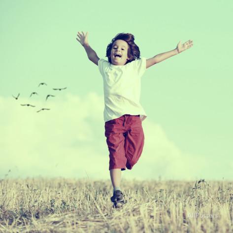 zurijeta-little-boy-running-feeling-happiness-and-freedom