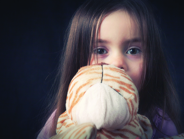 Young girl with cuddly toy