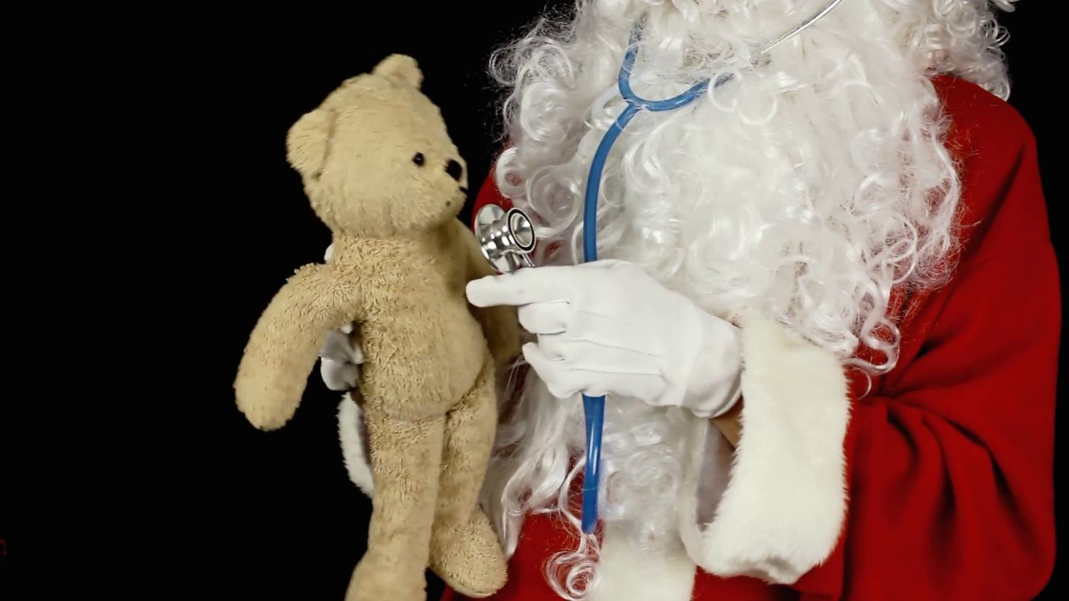 santa-claus-teddy-bear-doctor-santa-claus-acting-as-a-doctor-curing-a-sick-teddy-bear-listening-to-a-bad-cough-with-a-stethoscope_eyujrvkqx__F0000