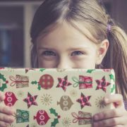 220469-675x450-Little-girl-holding-Christmas-present
