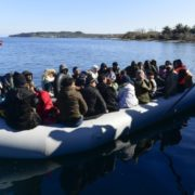 Local residents prevent migrants from reaching the small port of Thermi, on the Greek island of Lesbos, after crossing the Aegean sea on a dinghy from Turkey, Sunday, March 1, 2020. Migrants and refugees were trying to enter Greece by land and by sea Sunday despite Greece making clear it would not allow anyone in, after Turkey officially declared its western borders open to those hoping to head into the European Union. (AP Photo)